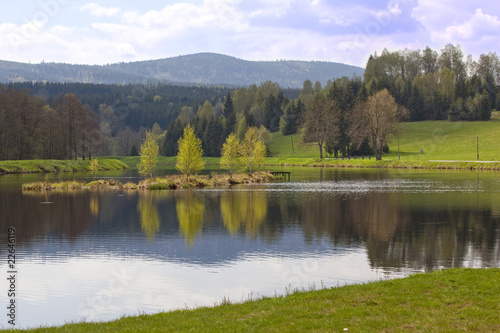 Foto op Aluminium Pistache Reflection of green spring mountain on the lake. South Poland