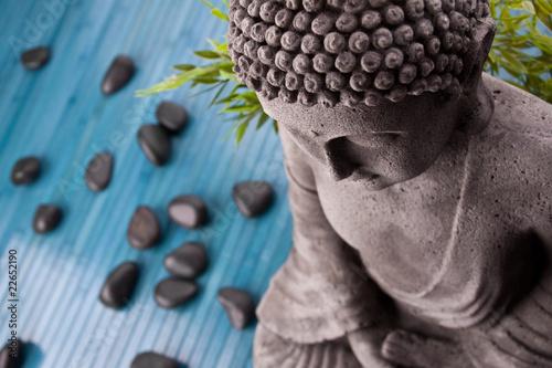 Foto op Plexiglas Boeddha Buddha mit Bambus und Massage Steinen