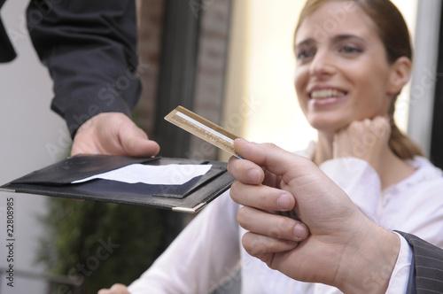 Fotobehang Restaurant Hand of a man paying a bill in a restaurant