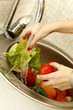 Close up of woman washing vegetables