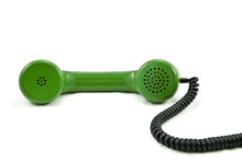 Old Telephone Receiver With Cord On White Background