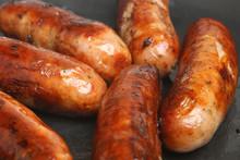 Sausages Frying In Pan