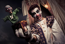 Photo Of A Scary Clown Holding A Jack-in-the-box Toy