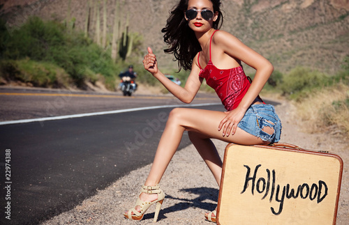 Fotografie, Obraz  Beautiful woman hitching a ride to Hollywood