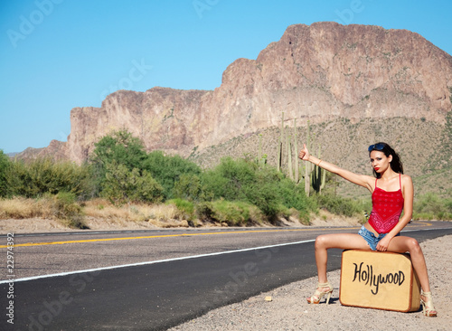 Photo  Beautiful woman hitching a ride to Hollywood