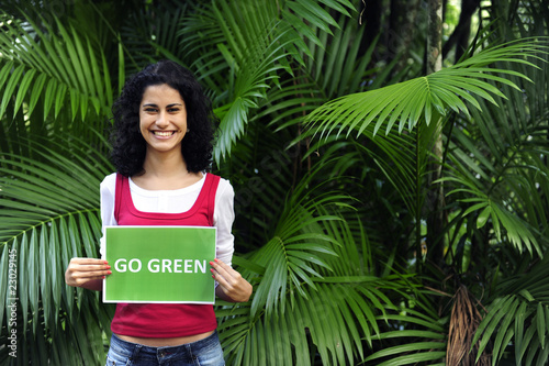 Fotografie, Obraz  woman in the forest holding a go green sign