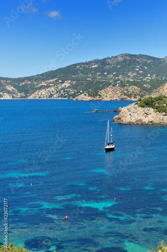 Poster Turquoise Sailboat on the west coast of Ibiza