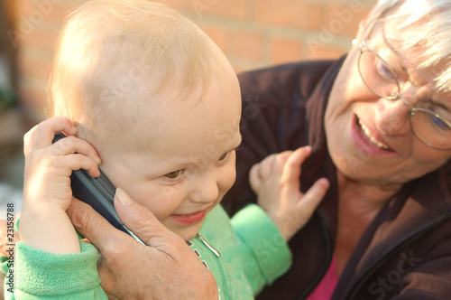 Poster Attraction parc phoning child with grandmother _ outdoor