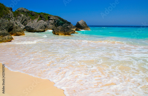 Sandy beach and rocky coastline with blue ocean water (Bermuda) Wallpaper Mural