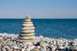 White pebbles stacked on sea shore