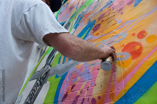 Graffitist Applying Spray Paint © trailfan