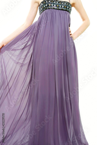 Garden Poster close up of young lady in long purple dress over white