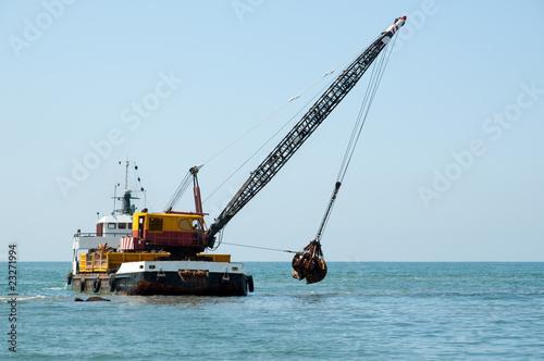 Valokuva  Barge dredging a harbor