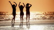Girls Having Fun Dancing on Beach at Sunset