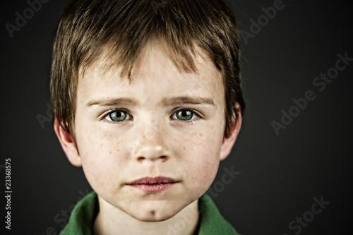 Photo  Boy with bright green eyes