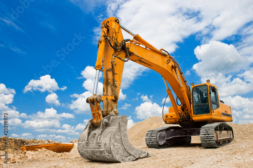 Wallpaper Mural Yellow Excavator at Construction Site