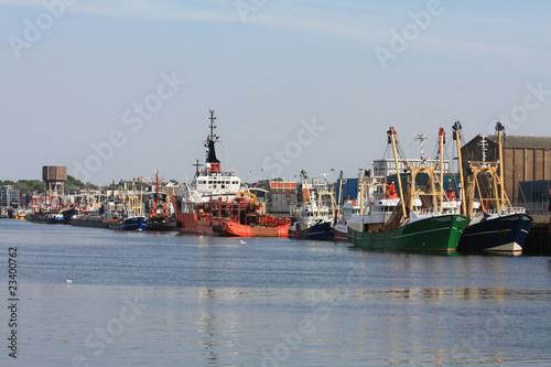 Valokuva  Fishing trawlers in harbor