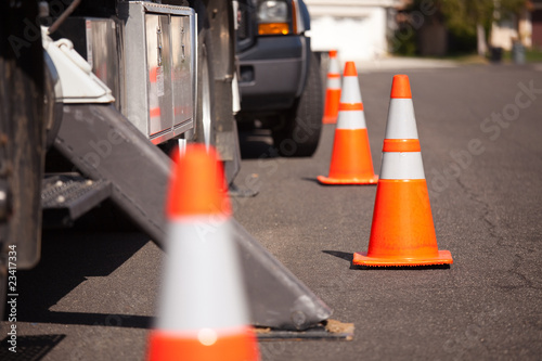 Fotografie, Obraz  Orange Hazard Cones and Utility Truck in Street