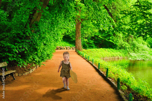 A little girl runs to meet. Canvas Print