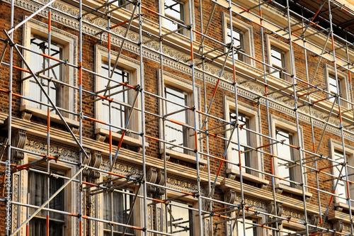 Obraz na plátně Fragment of a scaffolded house wall in West London