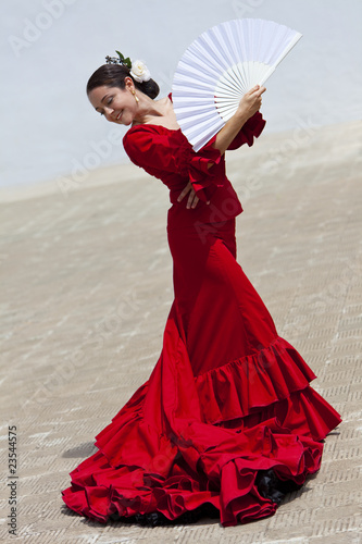 Traditional Woman Spanish Flamenco Dancer In Red Dress With Fan Fotobehang