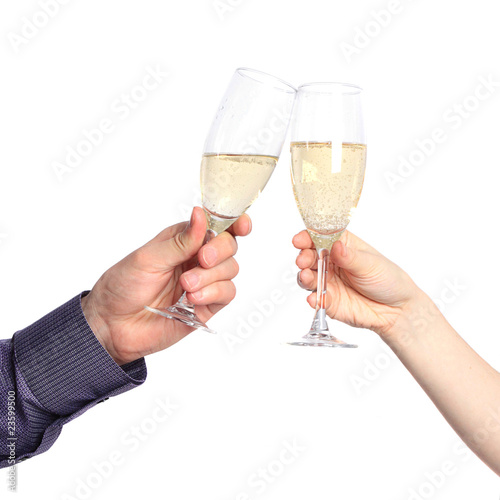 Two hands with glasses of champagne isolated on a white backgrou