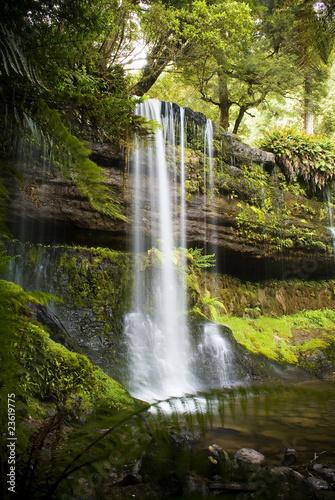 Keuken foto achterwand Watervallen Waterfall In Lush Green Forest