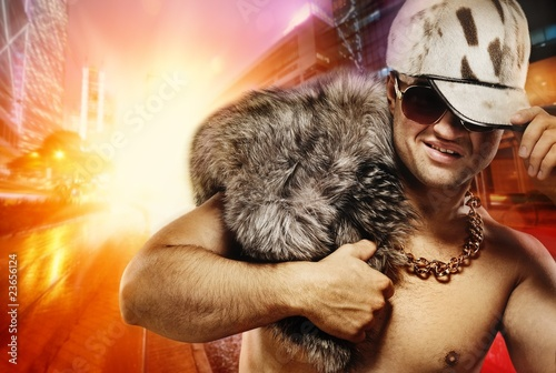Stylish glamorous rapper in front of night city Tablou Canvas