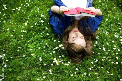 Fotografie, Obraz  Woman lying on grass, reading book
