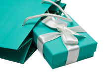 Gift Box With White Bow And Gift Bag On The White Background