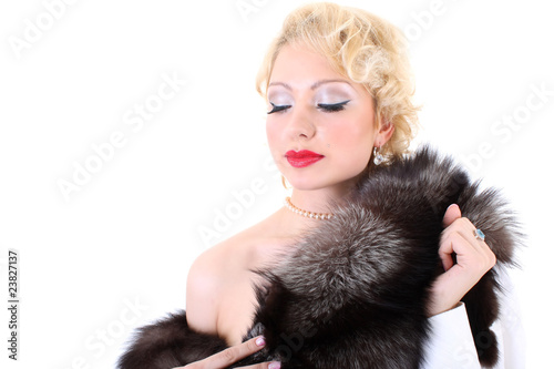 Photo  Blondie woman with fur collar dreaming. Marilyn Monroe imitation