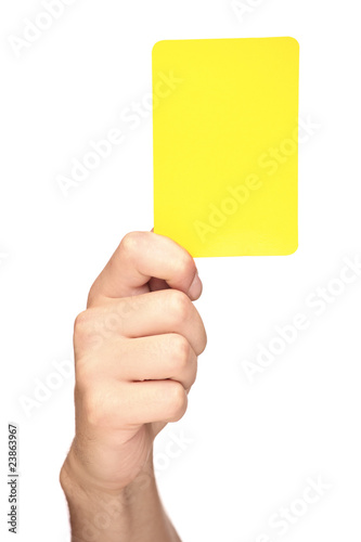 Hand holding a yellow card isolated on white Canvas Print