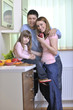 happy young family in kitchen