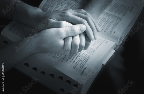 Slika na platnu Holding Hands Over The Bible