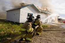 Fire Fighters Spray Burning Building