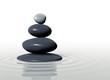 Zen - stones in balanced pile in calm water