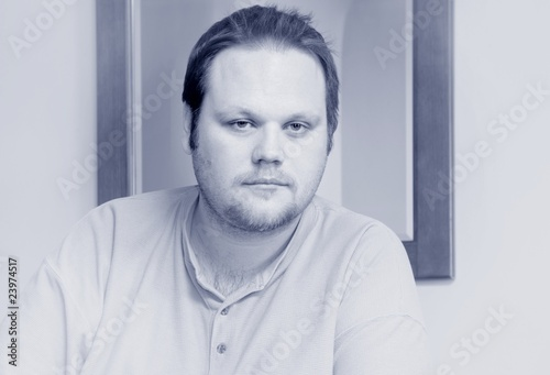 Single Man Staring Into Space - Buy this stock photo and