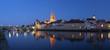 canvas print picture - Panorama der Altstadt Regensburg mit Dom und Steinerne Brücke zur blauen Stunde bei Nacht