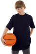 Young boy holding a basketball isolated over a white background