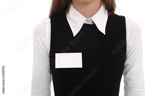 Fotografía  A woman wears a blank name tag.