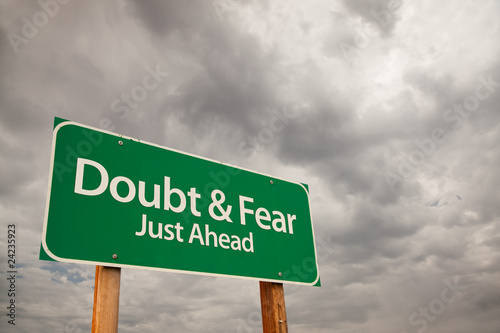 Photo Doubt and Fear Green Road Sign Over Storm Clouds