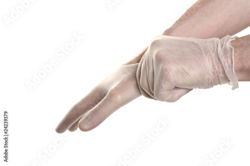 Photo Doctor pulling on surgical glove isolated over white