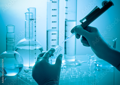 Photo hands  of a scientists working at laboratory