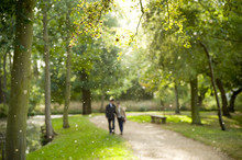 Couple Walking In The Park, Defocussed.