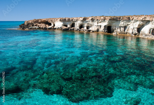 Photo Stands Cyprus Sea caves near Cape Greko. Mediterranean Sea.