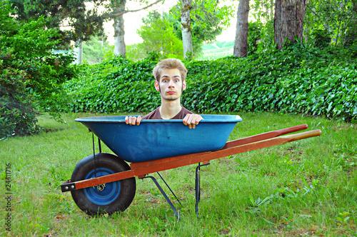 Fotografie, Tablou  Wheelbarrow with man inside