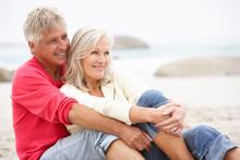 Senior Couple On Holiday Sitti...