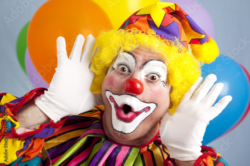 Leinwand Poster Clown macht lustiges Gesicht