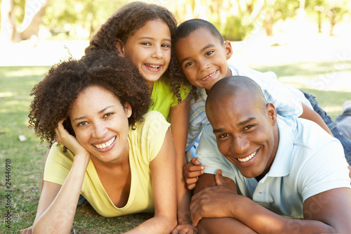 Fotografie, Obraz  Portrait of Happy Family Piled Up In Park