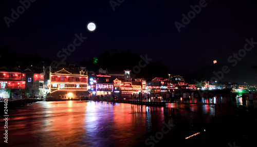 Photo Stands Full moon night scenery of the Phoenix Town in China